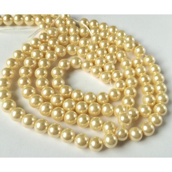 Üveg tekla gyöngy 8mm halvány arany